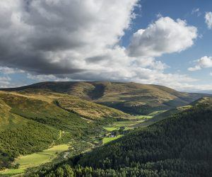 Panoramic shot of the College Valley and Cheviot from the summit of Great Hetha, Northumberland National Park