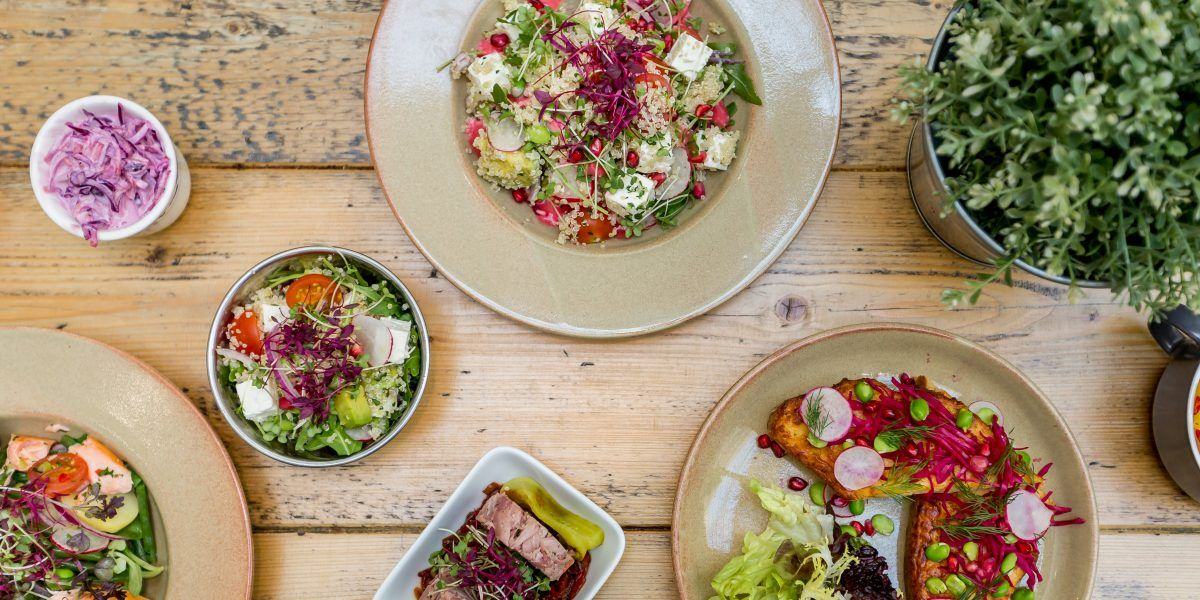 plates of salad on a wooden table