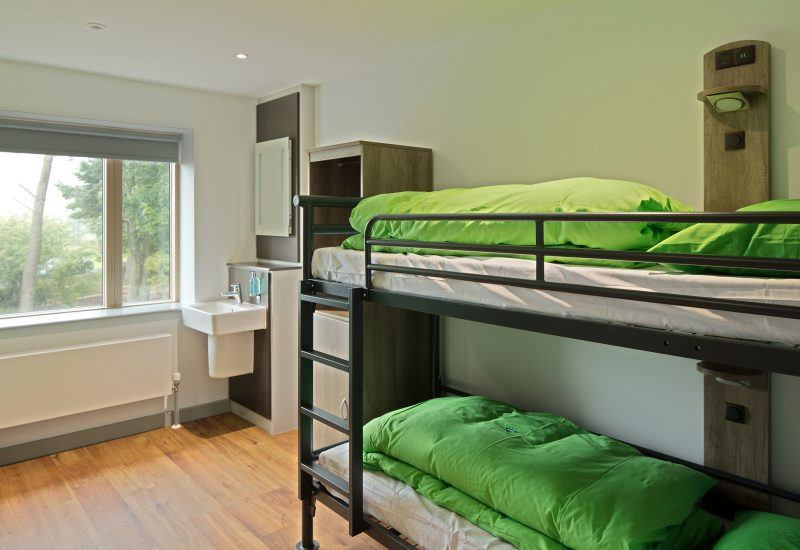 A bedroom in the Sill Youth Hostel