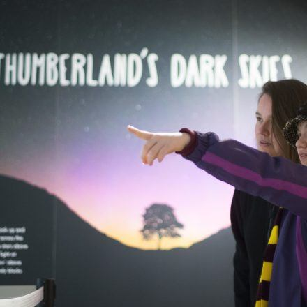 young visitors to the temporary Dark Skies exhibition