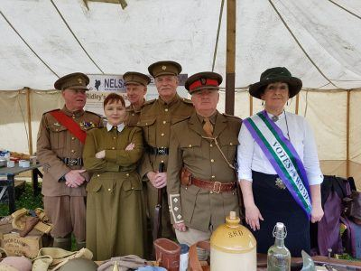 Men and women wearing WW1 clothing