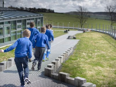 school children on the pathway of the sill roof