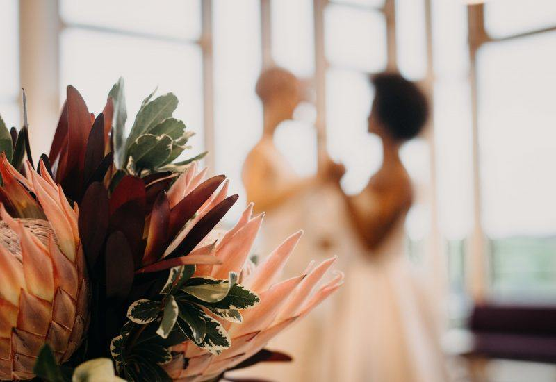 two brides dance at The Sill