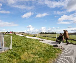 A wheelchair user on the the Grassland roof at The Sill