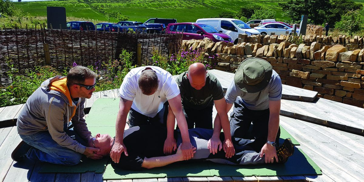 four adults take part in an Outdoor First Aid training courses