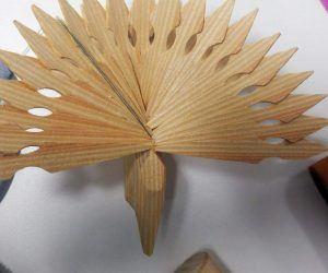 a wooden fan bird decoration on a desk