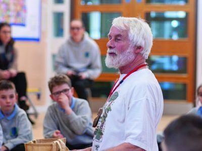 Storyteller Jim Grant speaking to primary school pupils