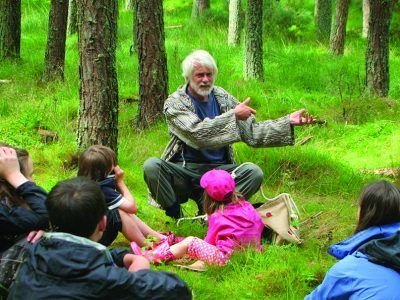 A storyteller talks to group of adults and children