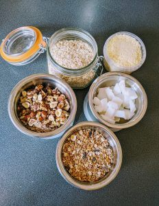 Six bowls full of fat, nuts and oats