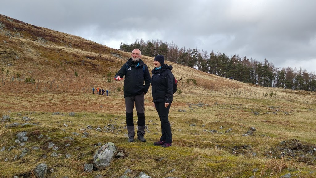 Rosie and a volunteer on an historic site in the National Park