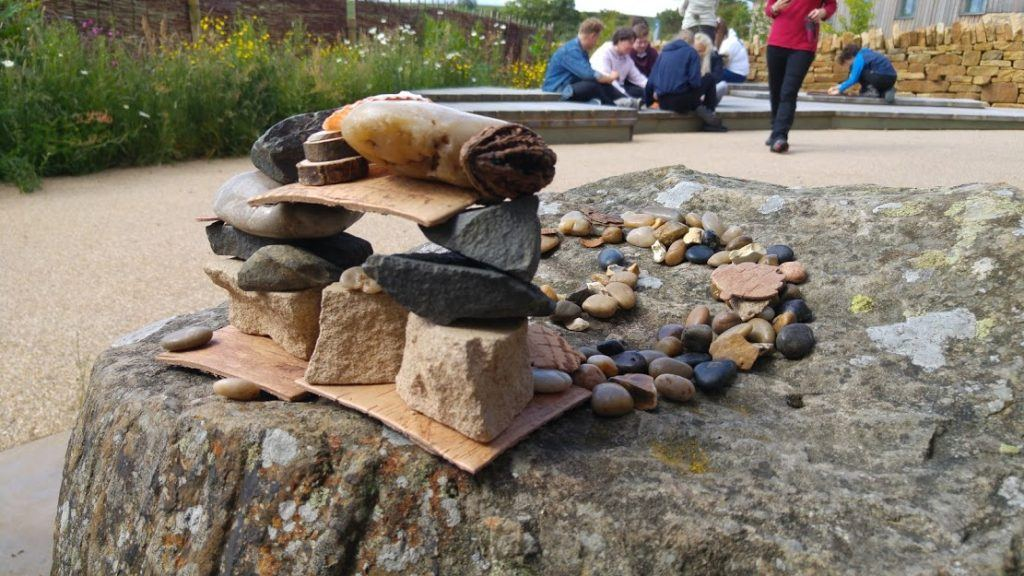 A scuplture made from rocks and wood