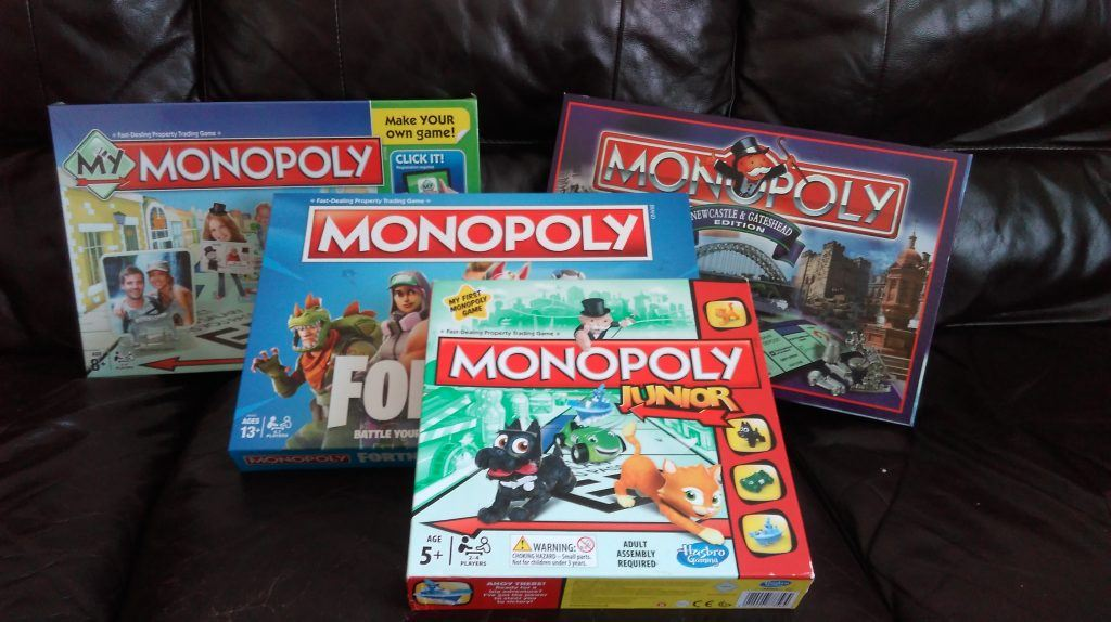 Four boxes of the board game Monopoly