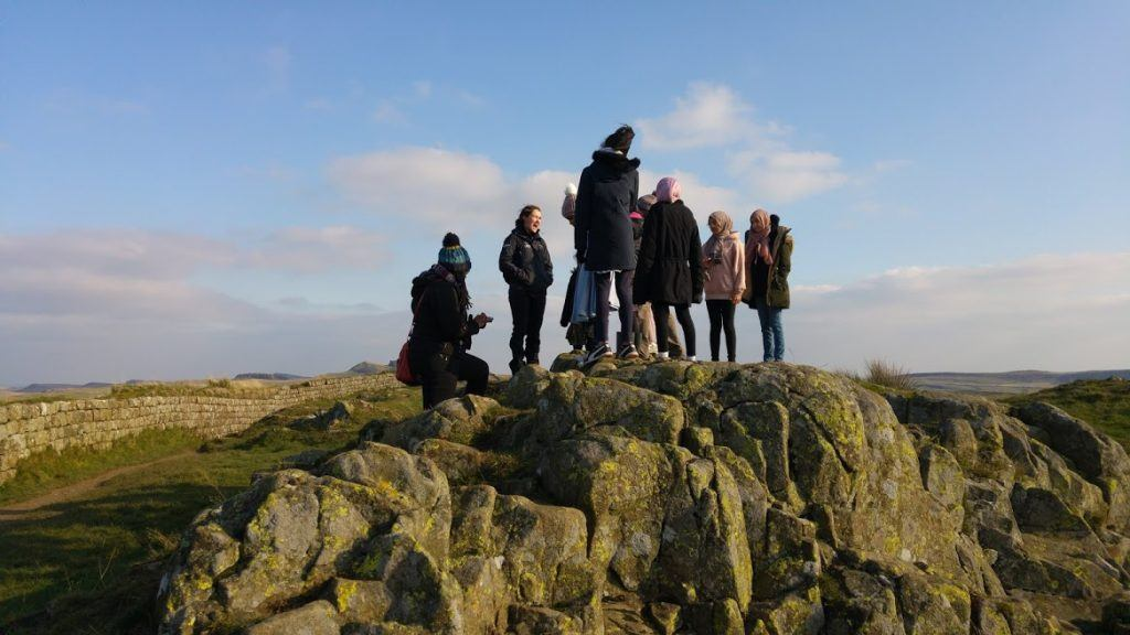 A group of visitors on Hadrian's Wall