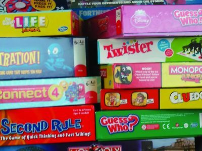 A pile of board game boxes
