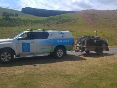 A National Park Ranger van with a trailer full of rubbish