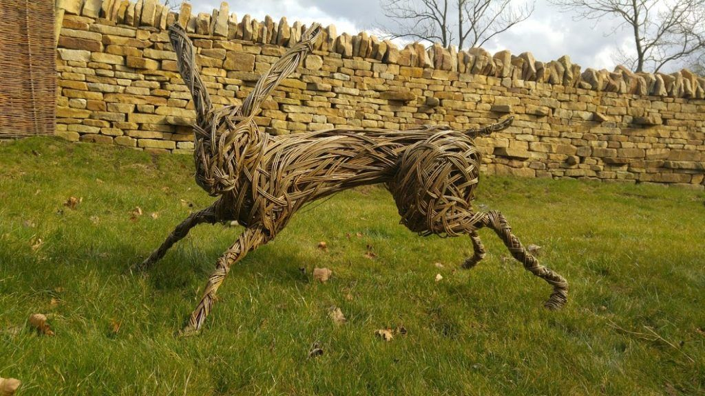 A running hare scuplture made from willow