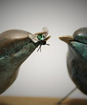 A sculpture of two birds