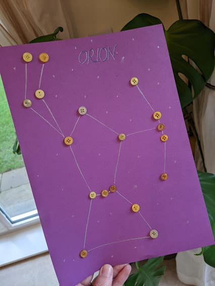 The constallation of Orion made using buttons on card
