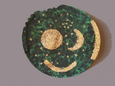 A homemade version of the Nebra Sky Disc; a paper plate with paintings of the Sun, Moon and stars on it.