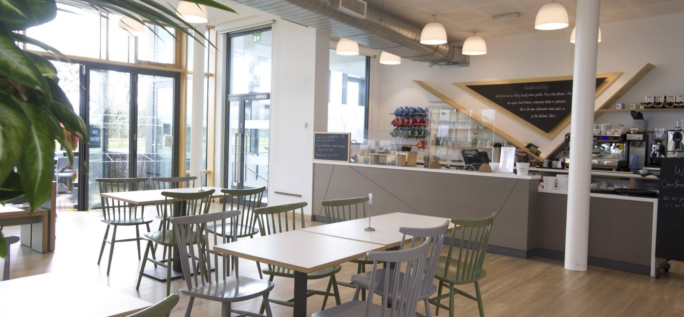 Tables and chairs in the light and airy Cafe in The Sill