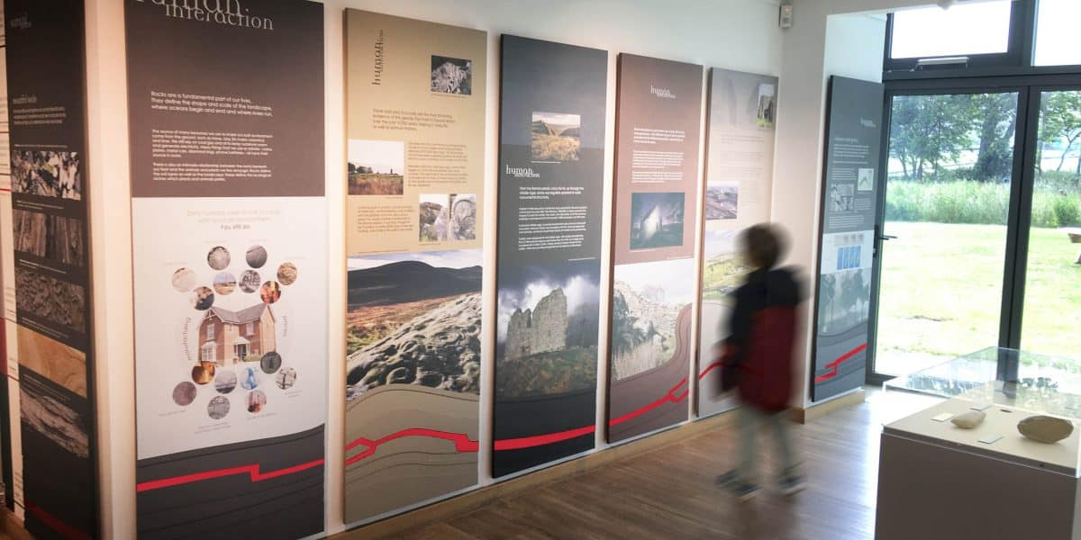 A child, blurred my movement, looks at part of the Stories in Stone exhibition