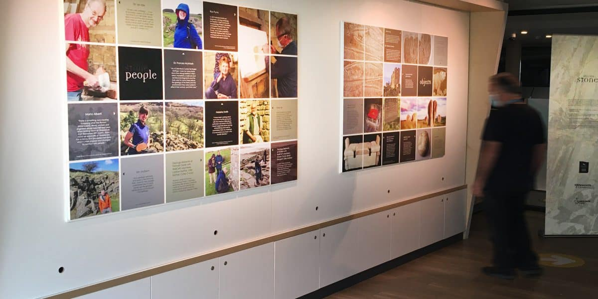 A view of panels on a wall at The Sill making up part of the Stories in Stone exhibition