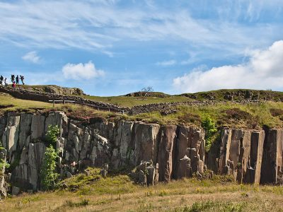 Walkers on the Hadrian's Wall path at the top of Walltown Crags