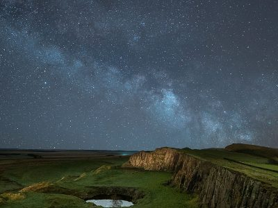 The star filled Milky Way at night about Walltown Crags in the Northumberland National Park.