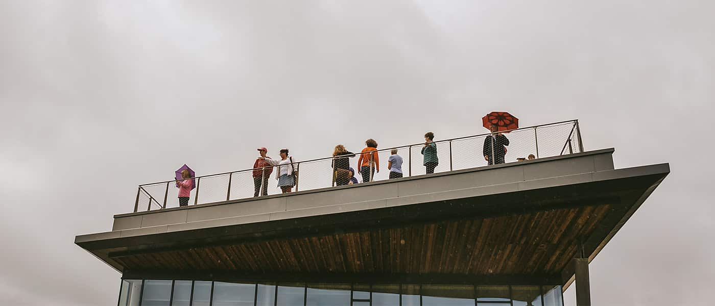 A group of people stand on the viewing platform on the roof of The Sill.