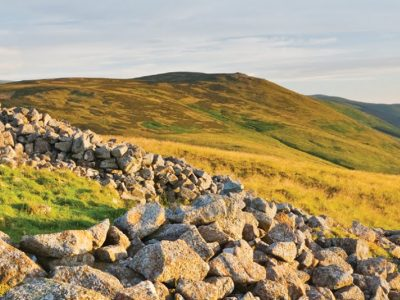 A photographs of the Cheviot hills taken from inside the remains of an ancient hillfort on top of Yeavering Bell.